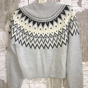 H&M gray holiday sweater with a festive motif